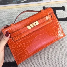 Hermes Orange Kelly Pochette Shiny Niloticus Crocodile Bag